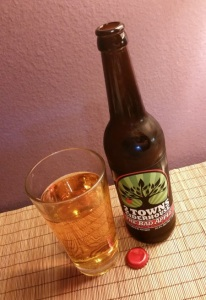 "Bottle & glass of 2 Towns ""The Bad Apple"""
