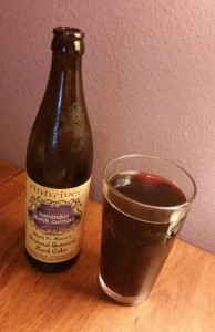 A bottle & glass of Finnriver Lavender Black Currant